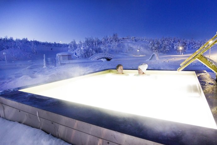 One highlight of the Swedish Lapland spa is sitting in the outdoor pool surrounded by snow.