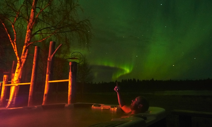 Nothing beats sitting in a hot tub at night watching the northern lights at a spa in Swedish Lapland