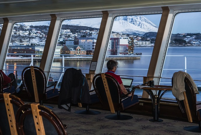 watching the scenery through panoramic windows on the MS Finnmarken