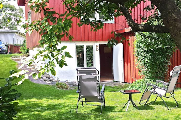 You can rent this Gothenburg flat which occupies a traditional red-painted house