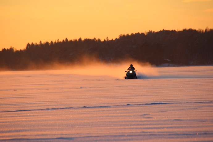 Winter is the perfect time to go snowmobiling in Finland
