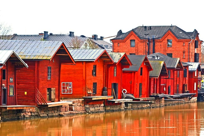 Porvoo, Finland has a pretty riverfront lined with red wooden houses