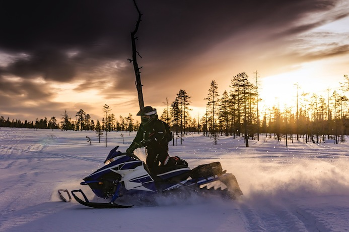 See the northern lights by snowmobile tour in Finnish Lapland
