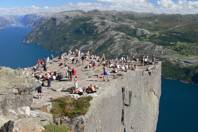 You can take an organised tour to the top of Preikestolen in Norway