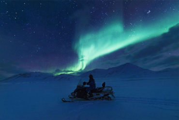 Northern Lights Hunt by Electric Snowmobile in Longyearbyen