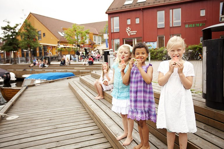 The lively Fiskebrygga fish market is a good place to browse in Kristiansand, Norway
