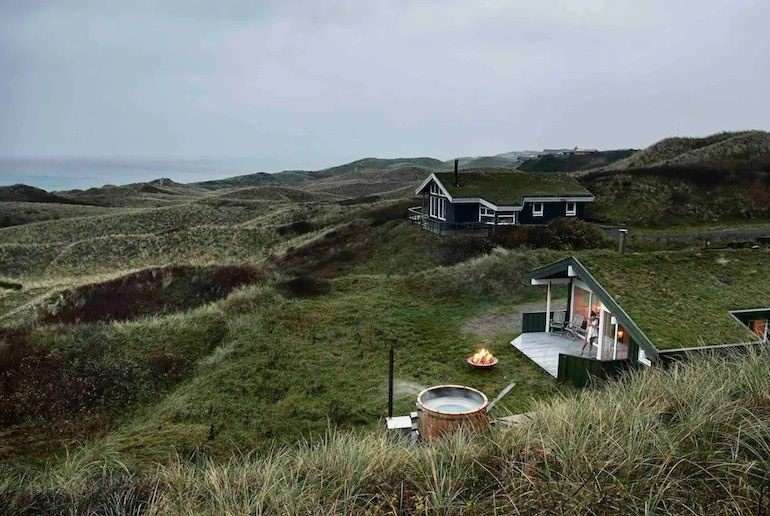 Cabin on the beach in Denmark with sea views and an outdoor hot tube in the dunes