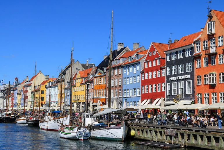 Lunch outdoors on Nyhavn is a great thing to do in summer in Denmark