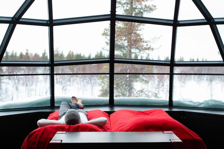 Watch the northern lights from your bed in a glass igloo in Finland