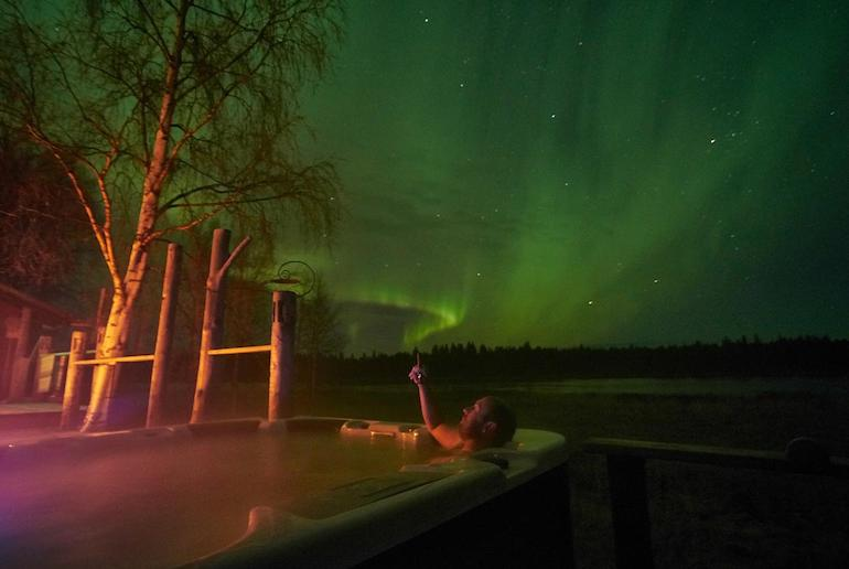 Have a festive hot tub while watching the northern lights at Christmas in Sweden
