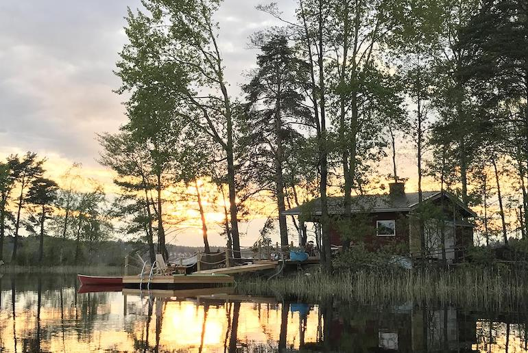 This wooden cabin sits on a private island in the middle of a lake in Finland.