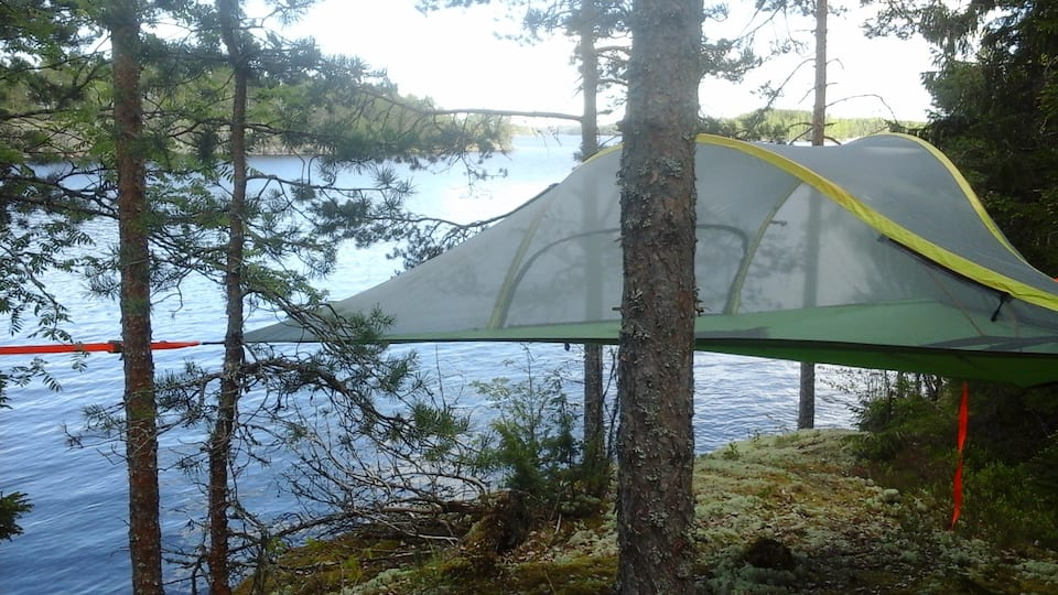 Hang out in a tent-in-a tree in the woods in Finland.