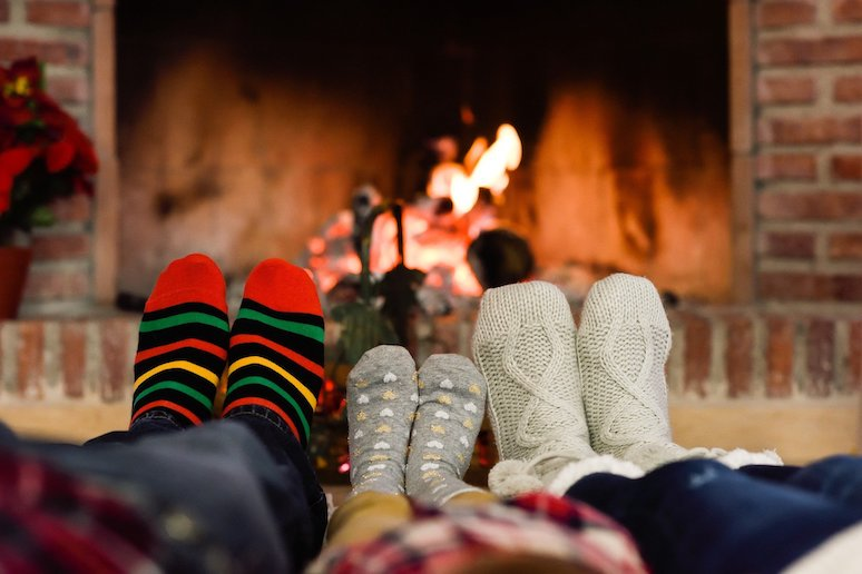 Cosying up by the fire with family or friends is a great way to experience hygge in Denmark.