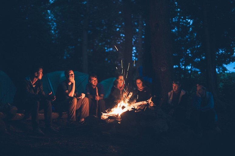 Dinner round a campfire with friends - what better way to embrace hygge with friends?