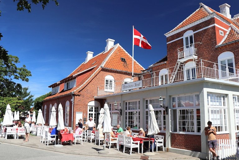 Few places reach the hygge levels of Skagen, with its yellow houses and red-tiled roofs, and cosy summerhouses in the dunes.
